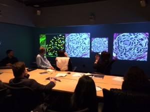 A delegation from Kyrgyzstan views biopsy slides in the RENCI Social Computing Room.